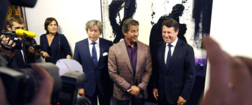 "US actor Sylvester Stallone (C) and Mayor of Nice Christian Estrosi (R) pose in front of an artwork at a retrospective of Stallone's paintings entitled ""Real Love"" Paintings 1975-2015 at the Museum of Contemporary Art in Nice, southeastern France, on May 16, 2015.  AFP PHOTO / FRANCK PENNANT = RESTRICTED TO EDITORIAL USE, MANDATORY MENTION OF THE ARTIST UPON PUBLICATION, TO ILLUSTRATE THE EVENT AS SPECIFIED IN THE CAPTION ="